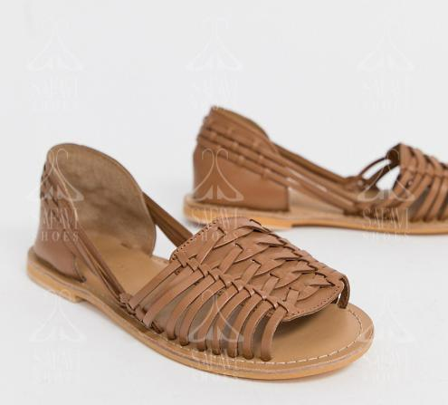 Properties of tan flat leather sandals